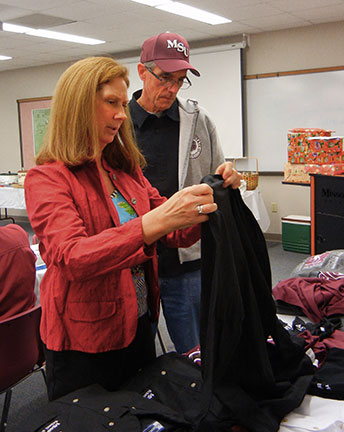 Mary Beth and Martin shop for Aggie shirts.