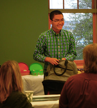 Qiang wins a book bag.