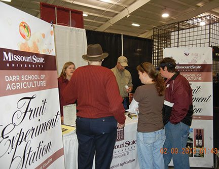 Susanne Howard and C. J. Odneal offer MSU wines to the participants at the Beer Wine Cheese and Chocolate Festival.