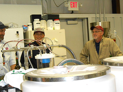 Chin-Feng (center) decided to sample some of the wine being bottled.