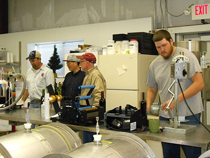 The bottling line from left to right - C. J. Odneal, Chin-Feng Hwang, Karl Wilker and Josh Glasson.