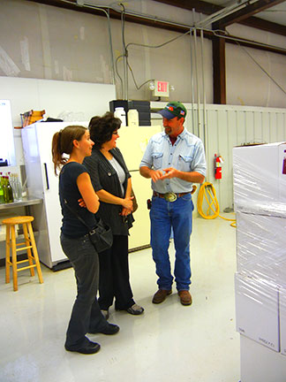 Melissa Warren (left) and Melissa Tolleson talk about the Mountain Grove Cellar wines with C. J. Odneal as they tour the facilities.