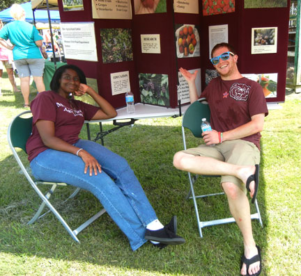 Shae and Michael working in the information tent.