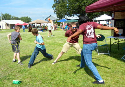 "Shae and Michael in a game of ""Ninja"" with two KidFest participants."