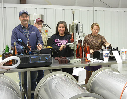 The bottling crew seems to enjoy the work.