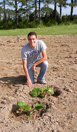 Logan is planting squash species to use in his breeding project.