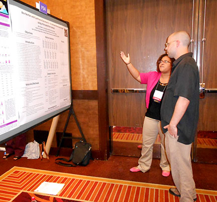 Mia discussing her poster entitled