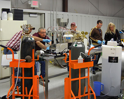 The bottling line begins with sparging the empty bottles with nitrogen to displace the oxygen before filling.