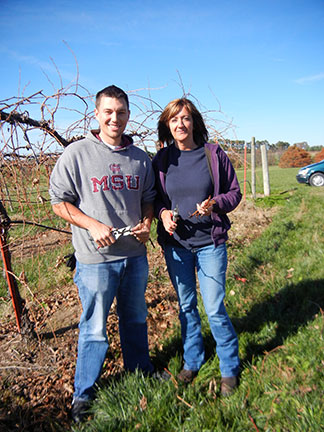 Ryan Wilson and Shelia Long collect dormant hardwood cuttings of Vidal Blanc grapevine to use to plant in locations where plants are missing.