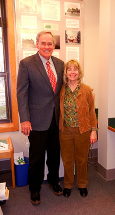 Dr. Elliott and Pam Mayer stand together for a photo in the Paul Evans Library of Fruit Science.