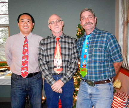 Chin Feng, Karl and C.J. compete in the annual tacky tie contest.