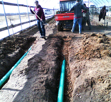 The perforated pipe is covered with some gravel and then they will be covered with soil.