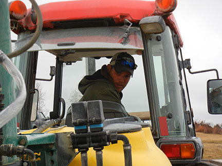 The tank is filled, the sprayer is then run at 16psi, and Jeremy times the spray for 1 minute.