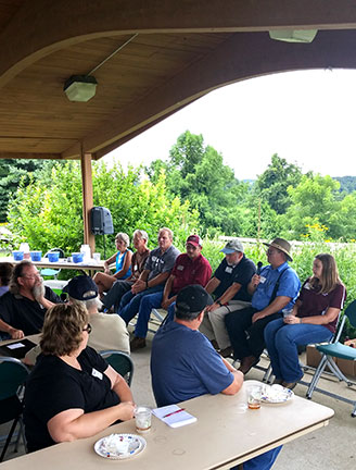 Participants questioned the panelists concerning high tunnel production. (from left to right) Deb French and Wayne Simpson of Simpson's Family Farm, Craig Jennings of Three Oaks Farm, Randy Stout of Missouri State, Patrick Byers of University of Missouri, Norman Kilmer of Morgan County Seed and Jennifer Morganthaler of Missouri State.