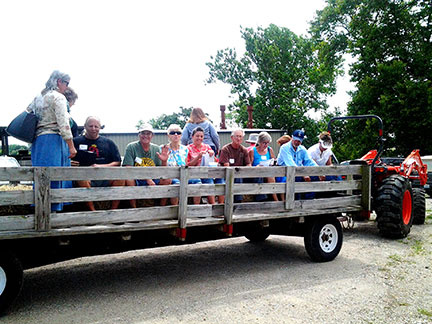 The hay wagon transported the group to the pavilion for the panel discussion lunch and later to the high tunnel.