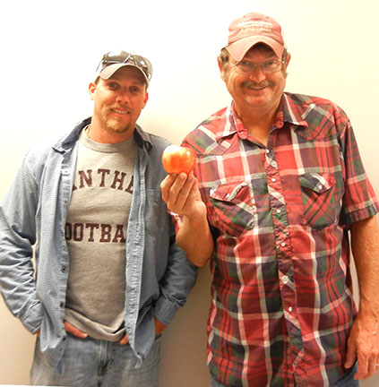 Jeremy (left) and Randy ran the booth for the Mountain Grove Fall Festival giving out apples and horticultural advice.