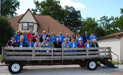 The USA tour participants board the hay wagon for the field and research tour.