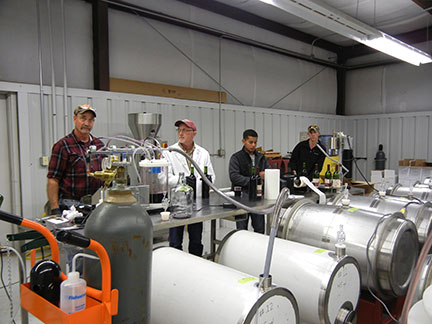 Here is the bottling line crew from left to right: C. J. Odneal, Dr. Karl Wilker, Manny McFall and Avery Crisp.