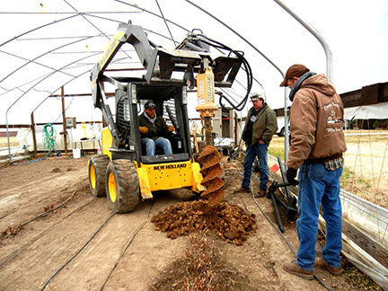 The skid steer was used to auger the holes about 4 feet deep.