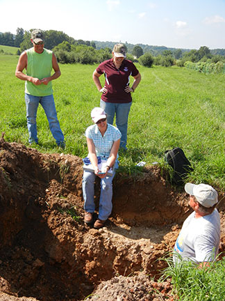 Tom DeWitt evaluates the soil pit and interprets it for us.