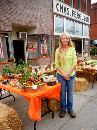 Kim Weimer, editor of the Howell County Newspaper, coordinates the garden harvest event.
