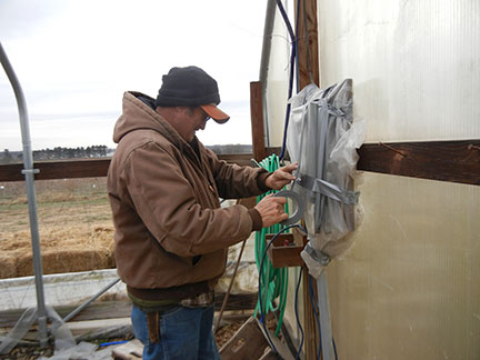 Randy covers the breaker box with plastic.