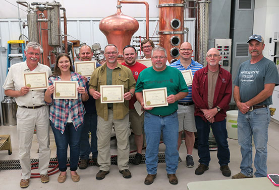 Here are the 2017 workshop grads along with Dr. Karl Wilker, the winery and distillery manager and C. J. Odneal, the cellar technician.