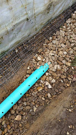 Here is a close-up of the pipe, gravel and hardware cloth.