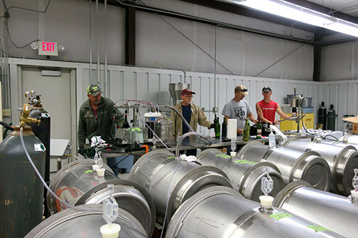 C. J. (left), Karl (Dr. Wilker), Tom and Avery are bottling Maroon Blend from 2017 to make room for the 2018 wine coming in.