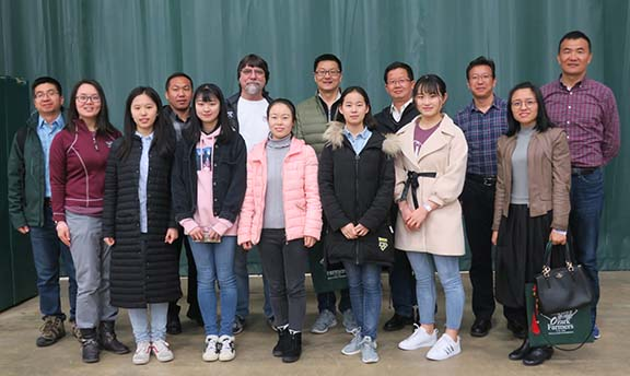 The five students from Ningxia (front and center) pose with Jinzi Fan, the Ningxia faculty and Mr. Teddy Gentry at the American Small Farm Conference.