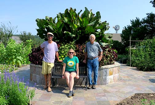 Jerre, Emily and Leroy in the garden in the center of the Pioneer Village.