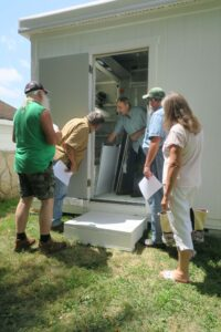 Bob shows each of the four groups the Mushroom Pod set-up and operation.