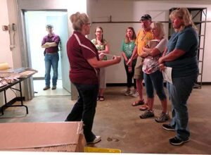 Leslie demonstrated the heat-wrap machine and discussed our labeling and marketing of the mushrooms in the project.