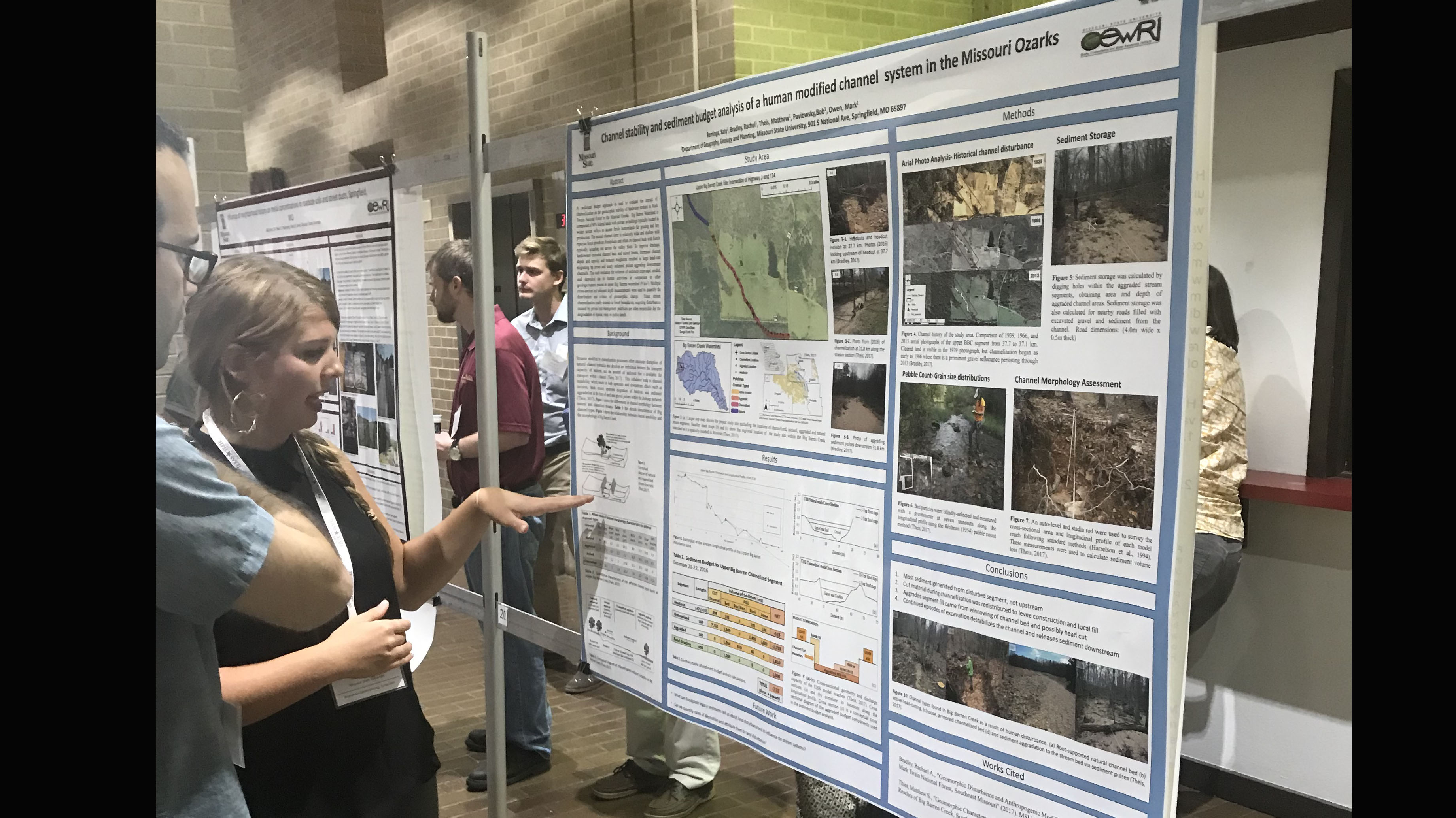 Katy Reminga discusses her poster.