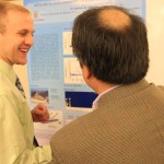 Student and professor interacting at Graduate Interdisciplinary Forum