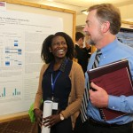 Student and professor interacting at Graduate Interdisciplinary Forum