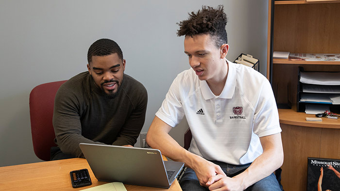 Howard Scarborough advising Missouri State student-athlete Darian Scott.