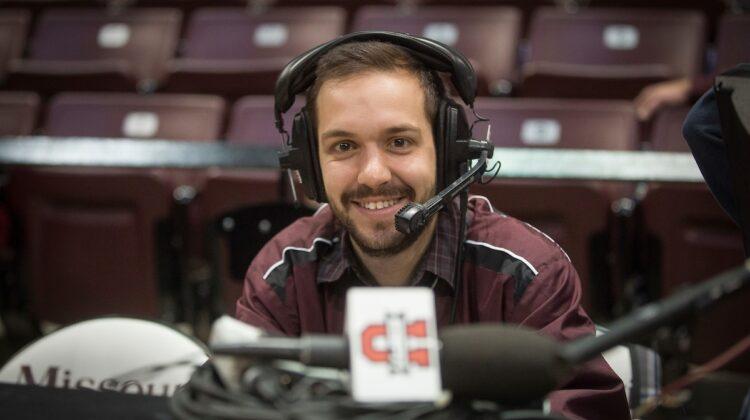 Matt Lerman wears a headset on press row before a Bears basketball game at JQH Arena.