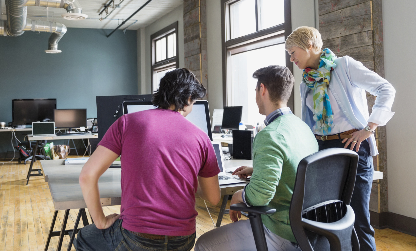 Entrepreneurs working in creative office space