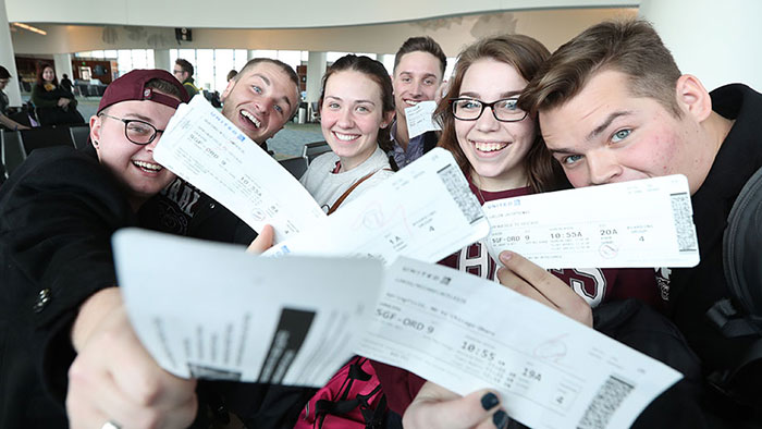 Chorale members with their plane tickets