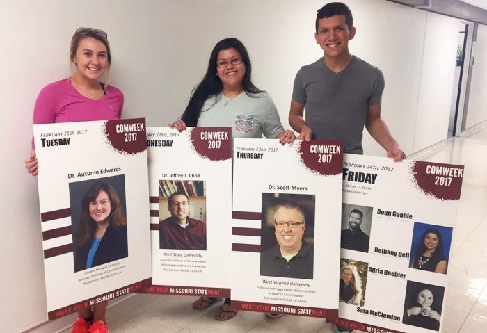 Students with COMWeek posters