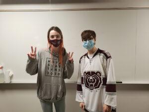 Photo of two debate team members in a class room (Photo Credit : Eric Morris)