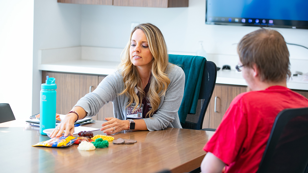 Jamie GNau works with client at MSU Care Clinic