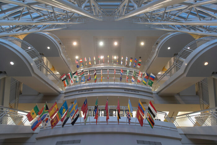 Strong Hall atrium with flags.