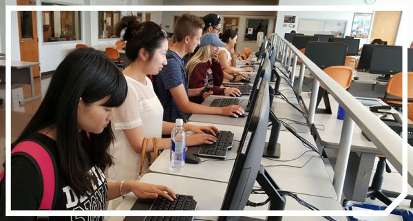 Photo of international students in a campus computer lab.