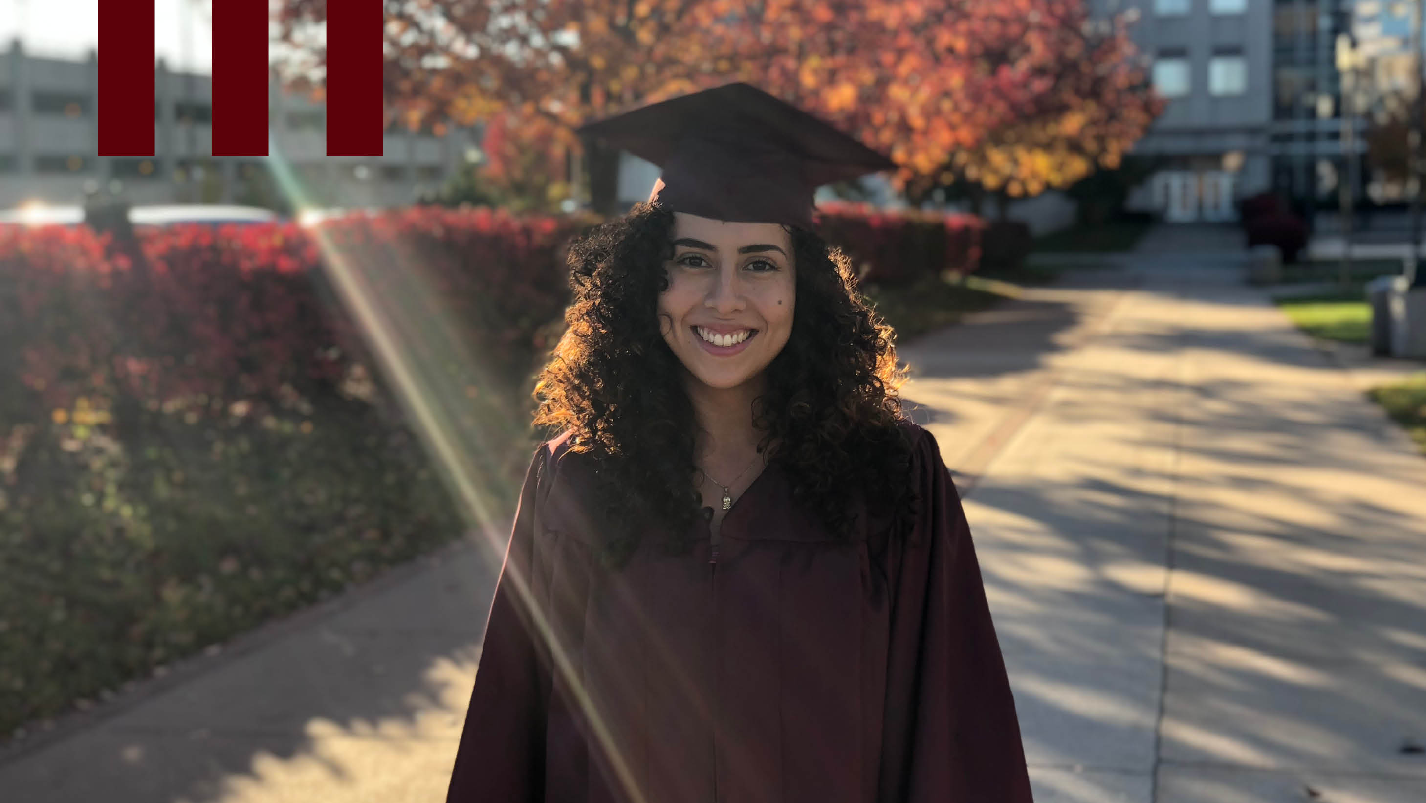 Laura Velandia, Construction Management Graduate from Missouri State University in her cap and gown on campus.