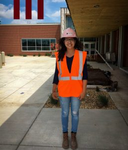 Laura Velandia on the job with Dewitt Construction in hardhat