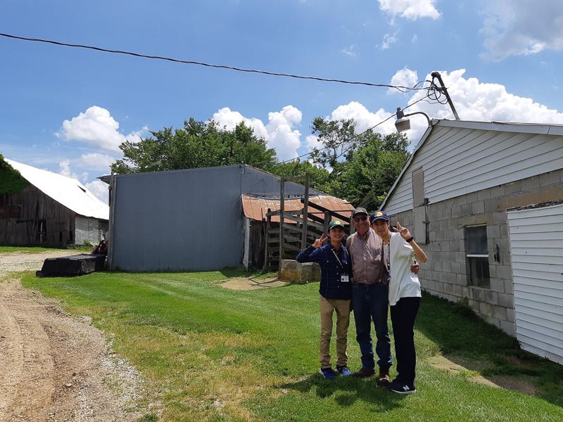 Takaki, Frank, and Kiichi pose on the farm