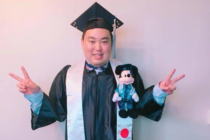 Motoki Yasui in his graduation cap and gown.