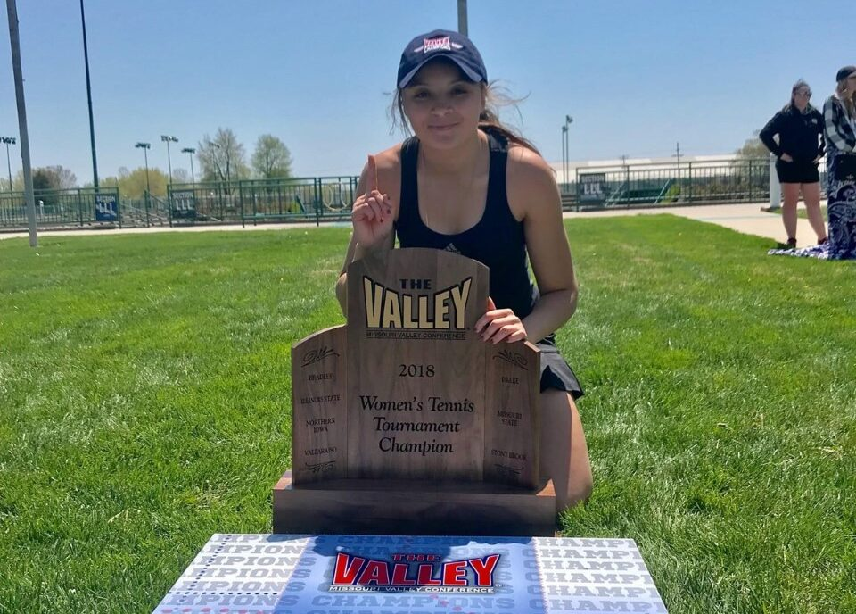 Faty holds the MVC tournament championship trophy.
